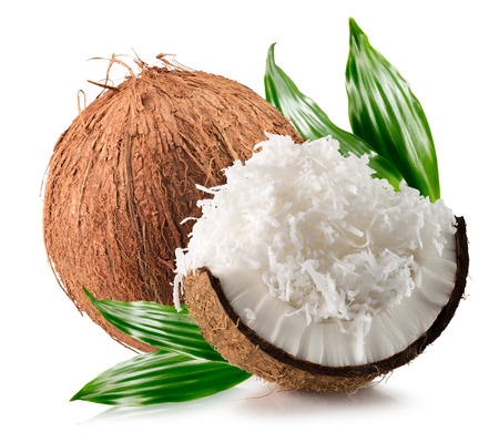 coconuts with coconuts flakes isolated on the white background. Imagens - 71369309