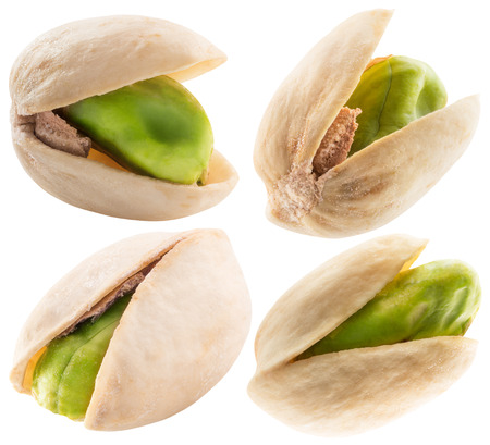 set of pistachios isolated on a white background. Banco de Imagens
