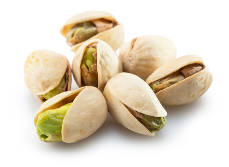 pistachios isolated on a white background. Banque d'images