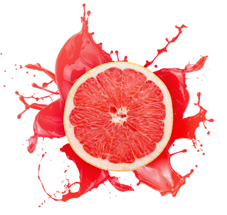 grapefruit with juice splash isolated on a white background. Foto de archivo