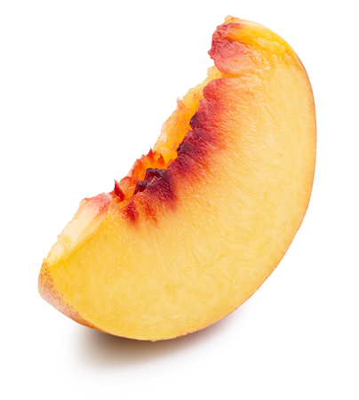 peach slice isolated on a white background.