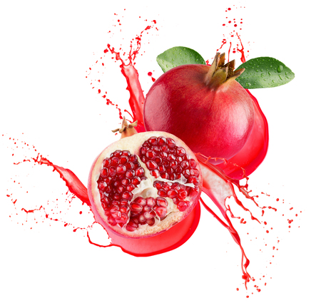 pomegranates in juice splash isolated on a white background. Banque d'images