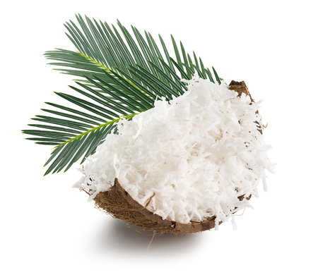 coconut with coconut flakes and palm leaves isolated on the white background.