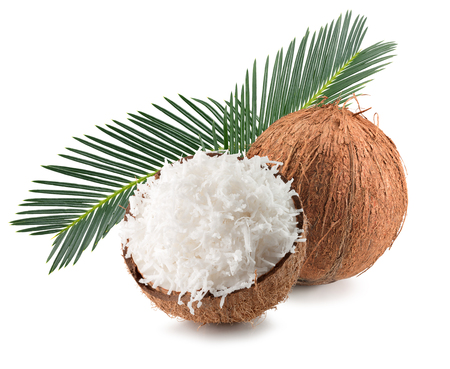 coconuts with coconut flakes and palm leaves isolated on the white background. Stock Photo