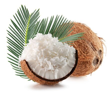 coconut with leaves and coconut flakes isolated on a white background.