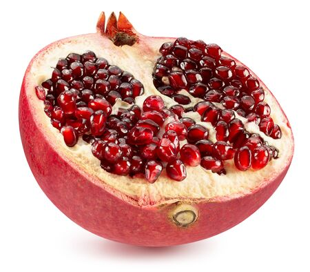 half of pomegranate isolated on a white background.