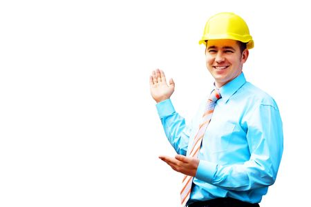 Young architect wearing a protective helmet standing on the building background Stock Photo - 7667551