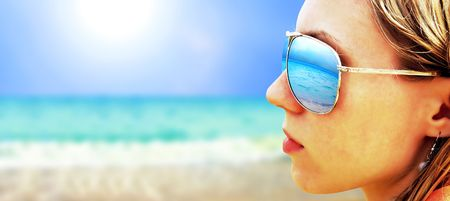 Young girl in Glasses is looking on the tropical sun beach Stock Photo - 7739775