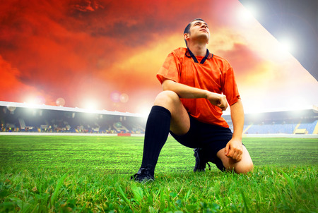 Happiness football player after goal on the field of stadium with blue sky Stock Photo - 7739750