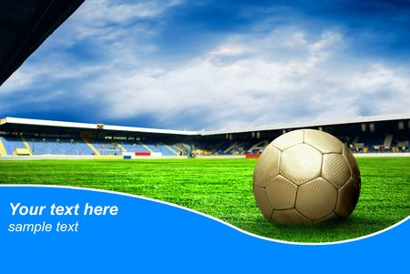 Ball on the field of stadium with blue sky and sample text Standard-Bild