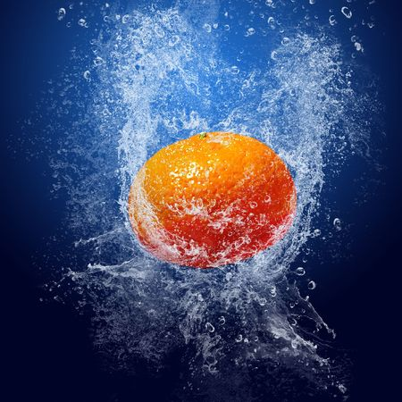 mandarin orange: Water drops around fruits on blue background