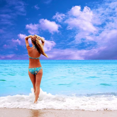 blue bikini: Young beautiful women on the sunny tropical beach in bikini