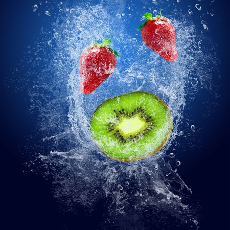 Water drops around fruits on blue background Stock Photo - 7768527