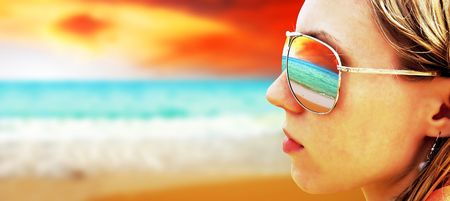 Young girl in Glasses is looking on the tropical sun beach Stock Photo - 7768371