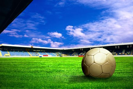 Happiness football player after goal on the field of stadium with blue sky Stock Photo - 7768460