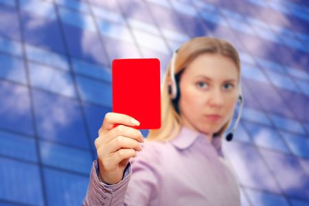 Red card in hand bussiness woman photo