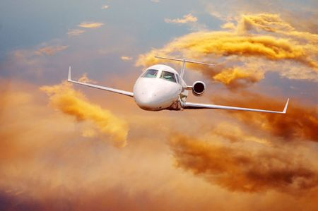 private plane: Airplane in air on sunrise sky  Stock Photo