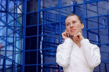 Business women in white on business architecture background  photo