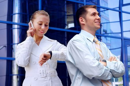 Business women in white and man on business architecture background  photo