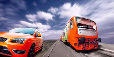 Beautiful orange sport car and train on road  Stock Photo - 7771799