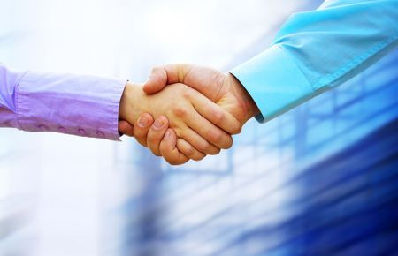 partnership power: Shaking hands of two business people
