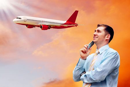 Happiness businessman on sunrise sky with airplane photo