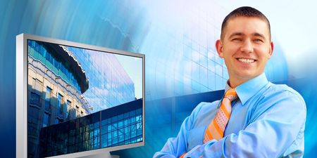 Happiness businessman in the business studio with monitors  photo