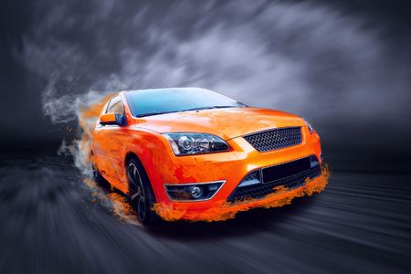 fire car: Beautiful orange sport car in fire