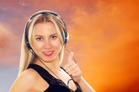 Portrait of sexy young women with beautiful face in headphones and listening music  photo
