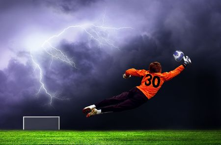 sport fan: Football goalman on lightning sky  Stock Photo