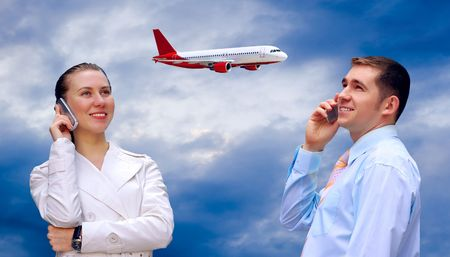 Happiness businessmens call by phone on blue sky with airplane background  photo