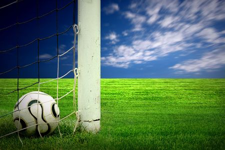 Soccer ball on green grass and sky background  photo