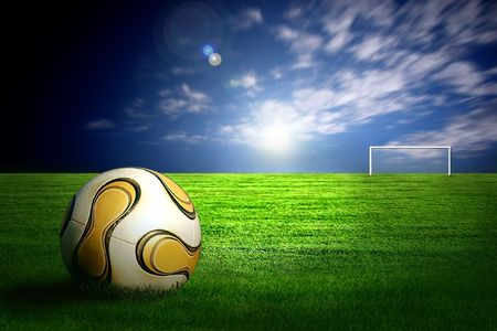 Soccer ball on green grass and sky background Stock Photo - 7772256