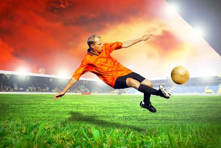 Happiness football player after goal on the field of stadium with blue sky Stock Photo - 7851255