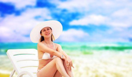 Young beautiful women on the sunny tropical beach in white bikini  photo