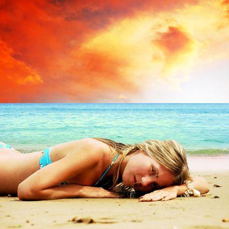 Young beautiful women on the sunny tropical beach in bikini photo