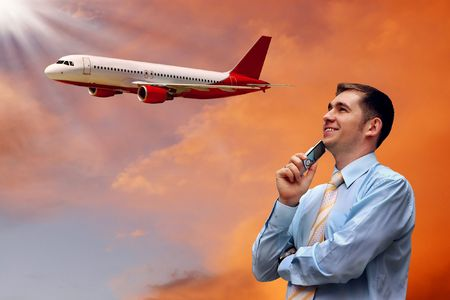 travel industry: Men look on airplane in air with sunrise sky  Stock Photo