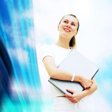 Young happy women or student with laptop on the business background Stock Photo - 7851313