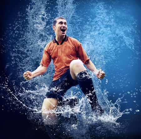 Water drops around football player under water on blue backgroun photo