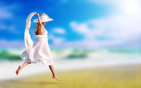 Young beautiful women in the white on the sunny tropical beach photo