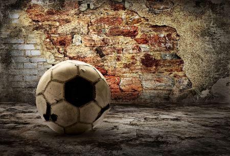 soccer background: Grunge ball on the retro grunge background