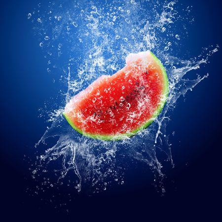 Water drops around watermelon on blue background  photo
