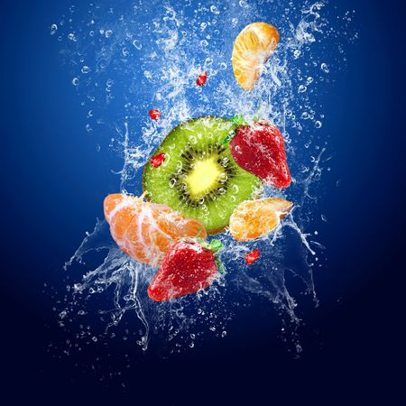 falling water: Water drops around fruits on blue background