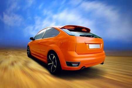Beautiful orange sport car on road photo