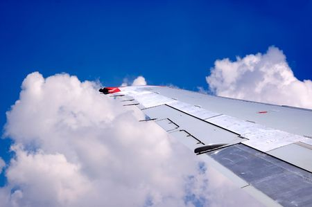Airplane on the blue sky  photo