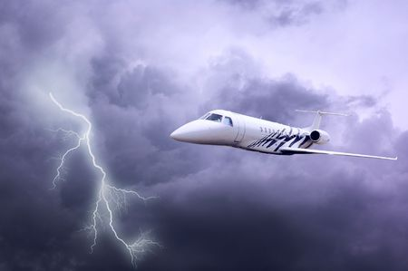 airplane in air on dark sky with lightning  photo