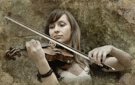Beautiful female violinist playing violin on the grunge background photo