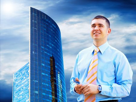 Businessman on the Modern business architecture background photo