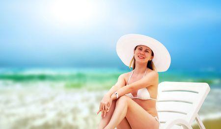 sensational: Young beautiful women on the sunny tropical beach in white bikini  Stock Photo