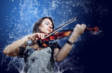 Musician playing violin under water photo